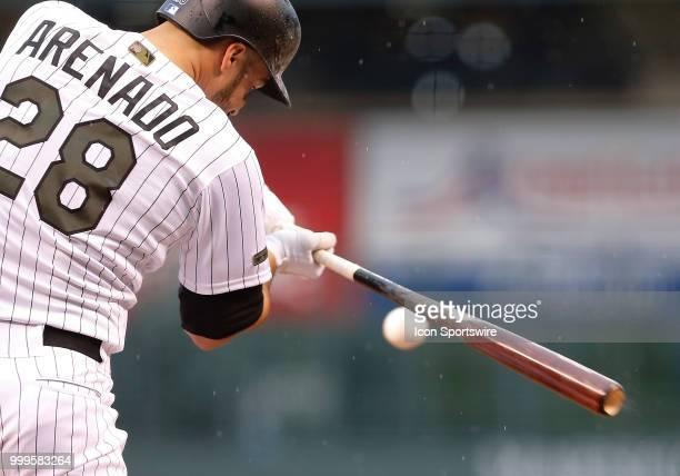 Colorado Rockies infielder Nolan Arenado bats during a regular season interleague MLB game between the Colorado Rockies and the visiting Seattle...