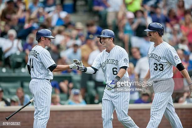 Colorado Rockies left fielder Corey Dickerson celebrates a tworun home run with first baseman Justin Morneau and second baseman Josh Rutledge during...