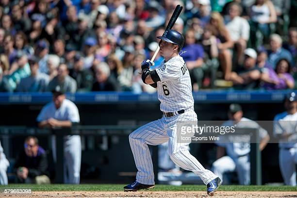 Colorado Rockies left fielder Corey Dickerson doubles during a regular season Major League Baseball game between the Chicago Cubs and the Colorado...