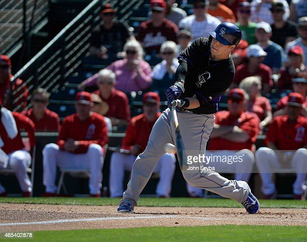 Colorado Rockies left fielder Corey Dickerson flies out to center field during the first inning against the Los Angeles Angels March 6 2015 at Tempe...