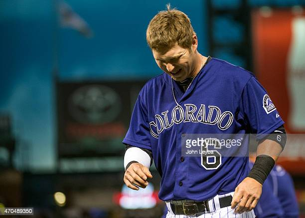 Colorado Rockies left fielder Corey Dickerson grimaces as he walks off the field during the fourth inning against the San Diego Padres April 20 2015...