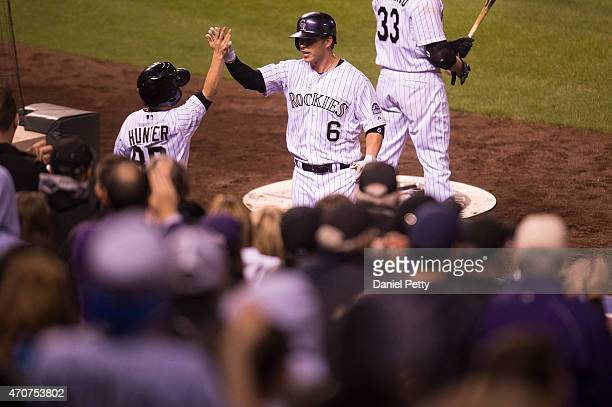 Colorado Rockies left fielder Corey Dickerson high fives Rockies bat boy Nick Hunter after Dickerson hit a solo home run in the 8th inning during an...