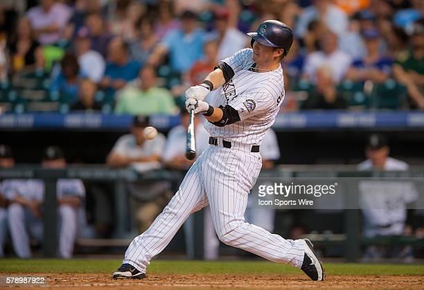 Colorado Rockies left fielder Corey Dickerson hits a home run to right field during a regular season Major League Baseball game between the...