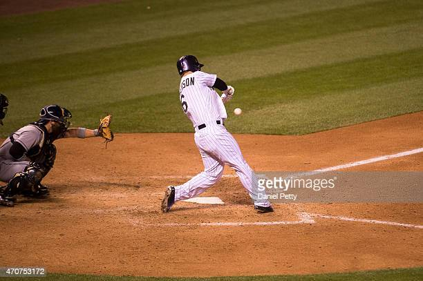 Colorado Rockies left fielder Corey Dickerson hits a solo home run in the 8th inning to tie the game at 44 against the San Diego Padres at Coors...