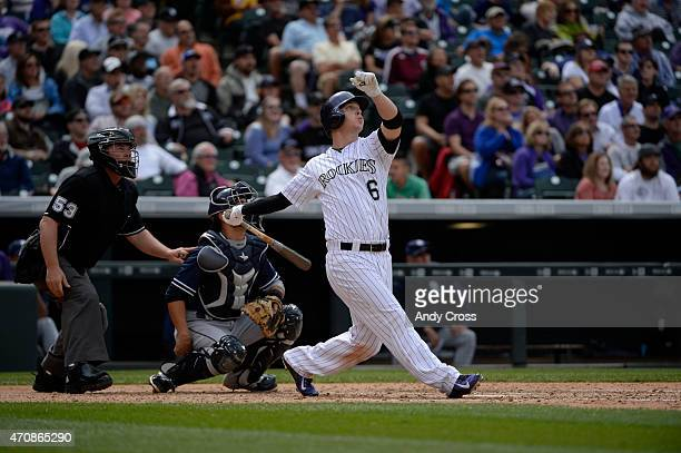 Colorado Rockies left fielder Corey Dickerson hits a solo home run against the San Diego Padres in the 5th inning at Coors Field April 23 2015...