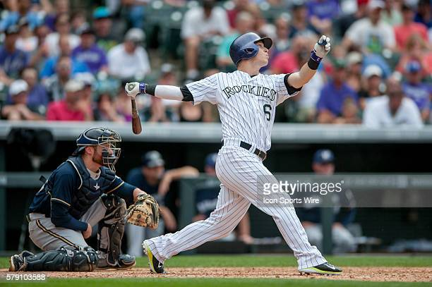 Colorado Rockies left fielder Corey Dickerson hits a tworun home run during a regular season Major League Baseball game between the Milwaukee Brewers...