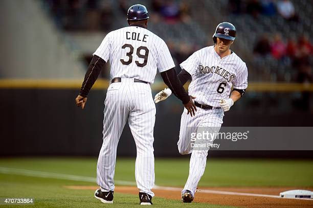 Colorado Rockies left fielder Corey Dickerson is congratulated by Rockies third base coach Stu Cole after a solo home run in the bottom of the first...