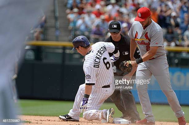 Colorado Rockies left fielder Corey Dickerson slides in to second base for a double and two run rbi as St Louis Cardinals shortstop Jhonny Peralta is...
