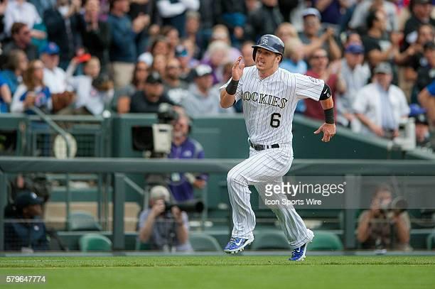 Colorado Rockies left fielder Corey Dickerson sprints towards home for a run during a regular season Major League Baseball game between the Chicago...