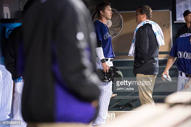 Colorado Rockies left fielder Corey Dickerson talks with assistant trainer Scott Gehret about injury during the 4th inning against the San Diego...