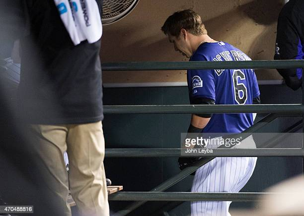 Colorado Rockies left fielder Corey Dickerson walks down the stairs to the clubhouse as he leaves the game with an injury during the 4th inning...