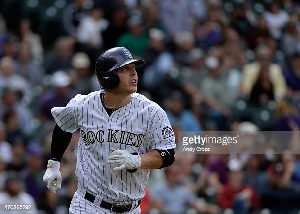 Colorado Rockies left fielder Corey Dickerson watches his solo home run shot against the San Diego Padres in the 5th inning at Coors Field April 23...