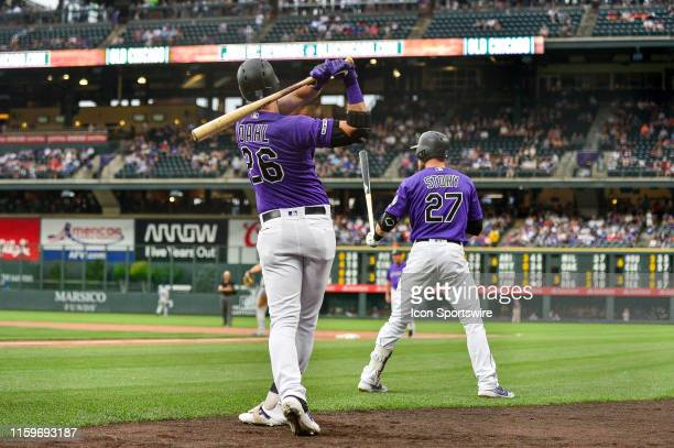 Colorado Rockies left fielder David Dahl and shortstop Trevor Story take swings in the on deck circle before batting against the Los Angeles Dodgers...