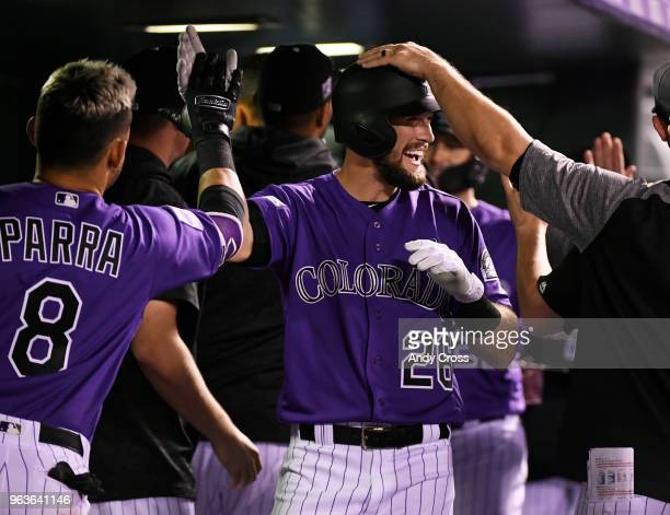 Colorado Rockies left fielder David Dahl gets congratulated after hitting a pinch-hit two run home run in the 7th inning against the San Francisco...