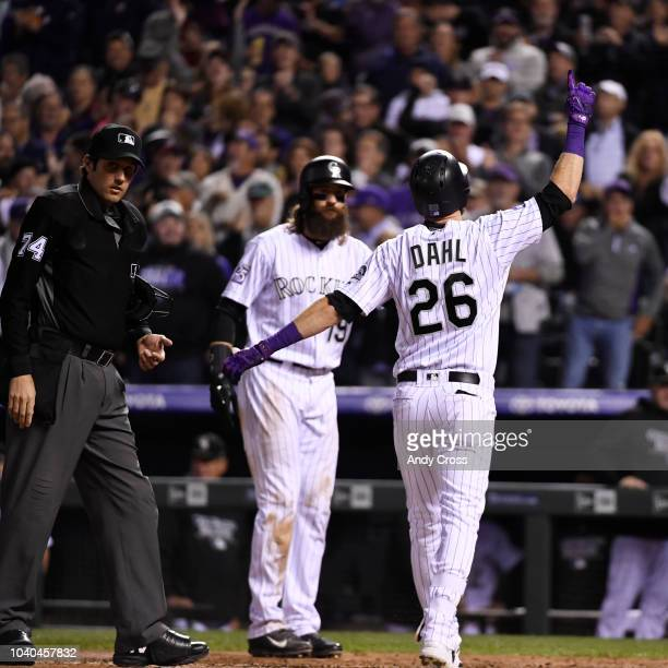 Colorado Rockies left fielder David Dahl points to the sky crossing home plate after hitting a three-run home run against Philadelphia Phillies...