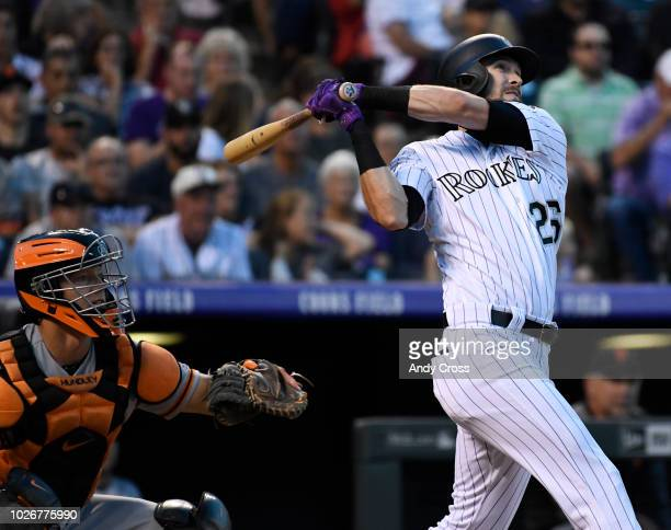 Colorado Rockies left fielder David Dahl watches his hit leave the ballpark on a solo home run against San Francisco Giants starting pitcher Dereck...