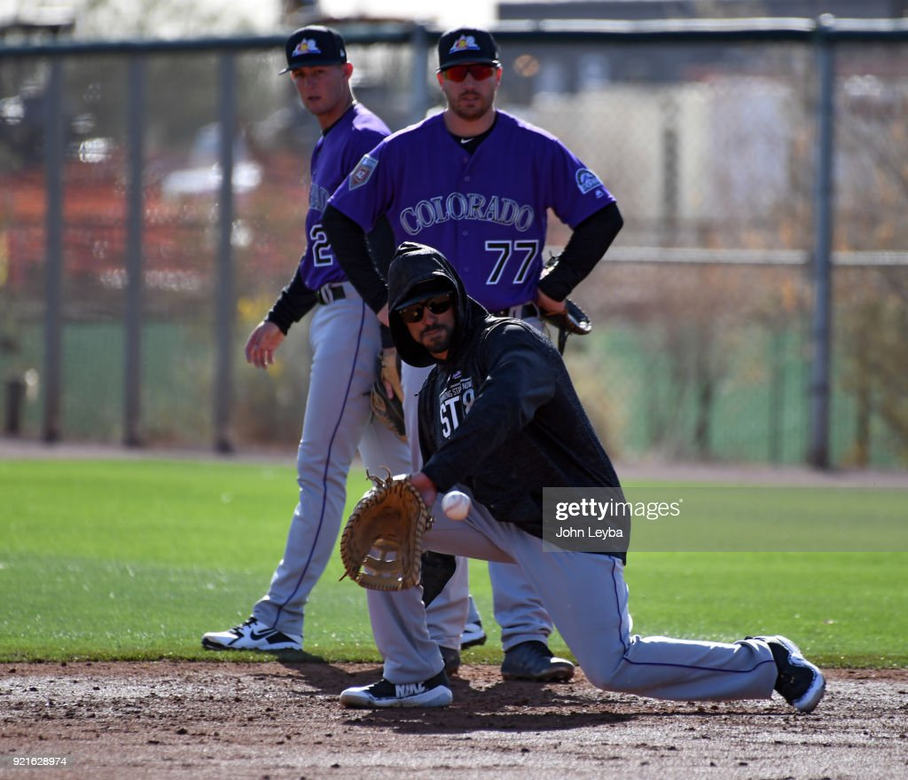 Colorado Rockies left fielder Ian Desmond (20) backhands a grounder during the teams workout on February 20, 2018 at Salt River Fields at Talking Stick in Scottsdale, Arizona.