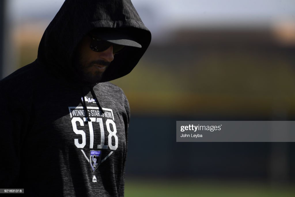 Colorado Rockies left fielder Ian Desmond (20) keeping cover with his hoodie during the teams workout on February 20, 2018 at Salt River Fields at Talking Stick in Scottsdale, Arizona.