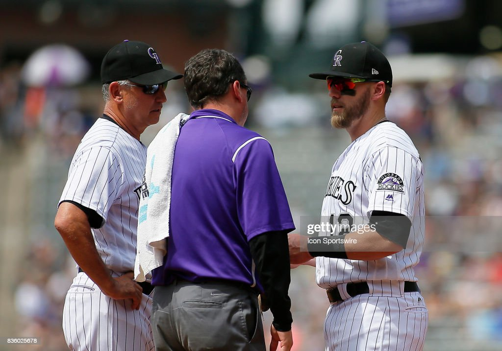Colorado Rockies Manager, Bud Black (10) and the Rockies trainer check on Rockies Infielder, Mark Reynolds (12) during a regular season MLB game between the Colorado Rockies and the visiting Milwaukee Brewers on August 20, 2017 at Coors Field in Denver, CO.