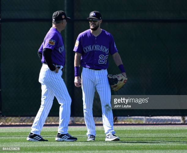 Colorado Rockies manager Bud Black chats with Colorado Rockies left fielder David Dahl during batting practice in left field during Spring Training...
