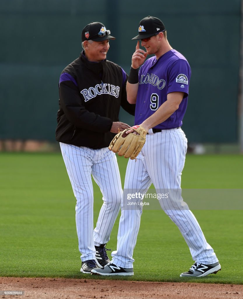 Colorado Rockies manager Bud Black (10) smiles as greets Colorado Rockies second baseman DJ LeMahieu (9) during the teams workout on February 19, 2018 at Salt River Fields at Talking Stick in Scottsdale, Arizona.