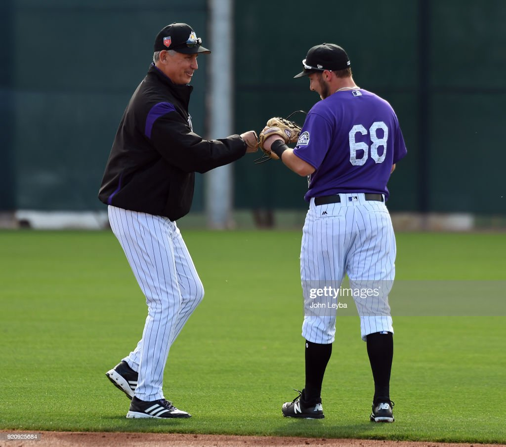 Colorado Rockies manager Bud Black (10) smiles as he gives a fist bump to Garrett Hampson (68) during the teams workout on February 19, 2018 at Salt River Fields at Talking Stick in Scottsdale, Arizona.