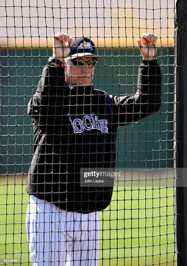 Colorado Rockies manager Bud Black (10) watches batting practice from behind the screen during the teams workout on February 21, 2018 at Salt River Fields at Talking Stick in Scottsdale, Arizona.