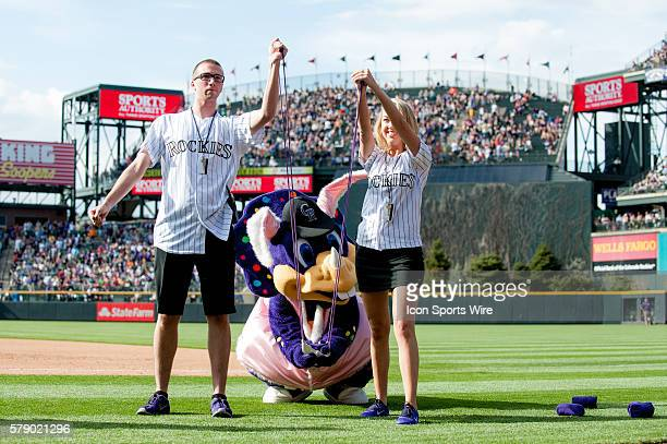 Colorado Rockies mascot Dinger sends tshirts into the crowd with a giant slingshot dressed as an easter bunny during a regular season Major League...
