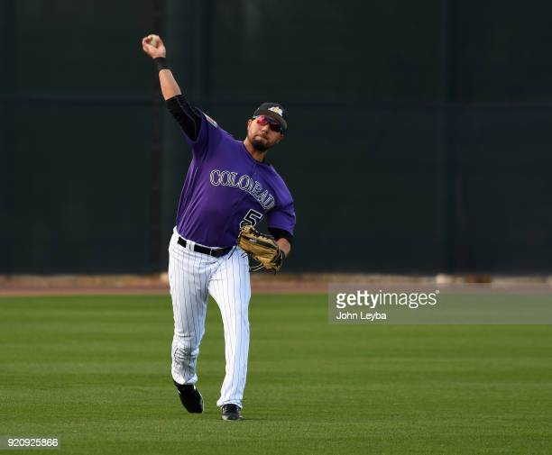 Colorado Rockies Noel Cuevas throws to third base in drills during the teams workout on February 19 2018 at Salt River Fields at Talking Stick in...