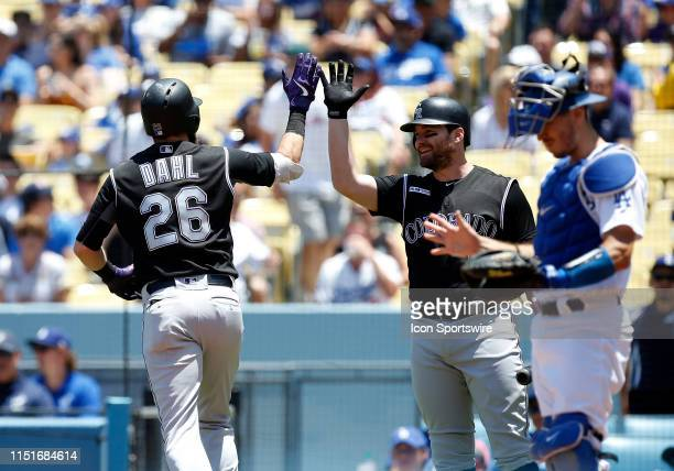 Colorado Rockies outfielder David Dahl gets congratulated by Colorado Rockies infielder Ryan McMahon after Dahl hit a solo home run during the game...