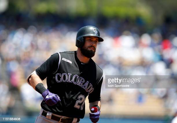 Colorado Rockies outfielder David Dahl hits a solo home run during the game against the Los Angeles Dodgers on June 23 at Dodger Stadium in Los...