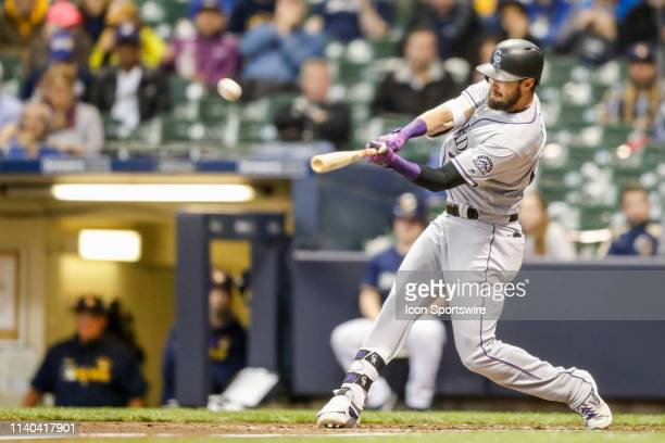 Colorado Rockies outfielder David Dahl hits it deep to right field but foul during the second game of a three game home series between the Milwaukee...