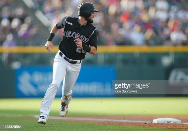 Colorado Rockies outfielder David Dahl rounds third base and score during the first inning of a game between the Colorado Rockies and the visiting...