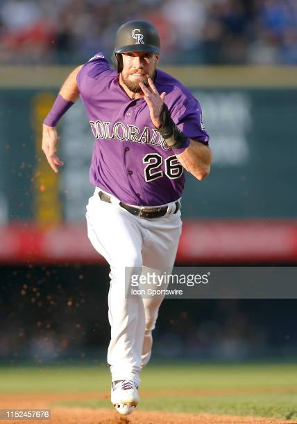 Colorado Rockies outfielder David Dahl runs towards third base during a game between the Colorado Rockies and the visiting Los Angeles Dodgers on...
