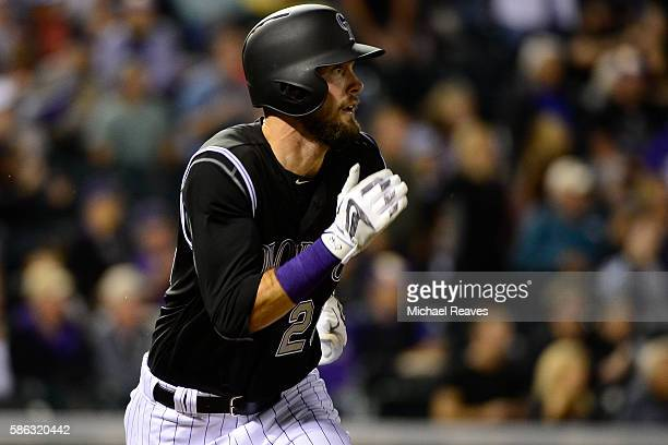 Colorado Rockies outfielder David Dahl singles home a run in the eighth inning of the game against the Miami Marlins at Coors Field on August 2016.