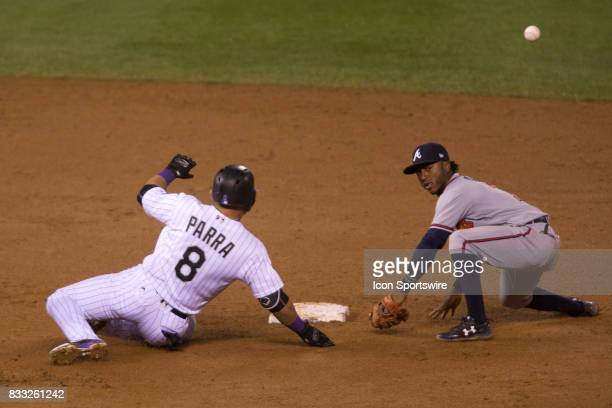 Colorado Rockies outfielder Gerrardo Parra slides into second as Atlanta Braves second baseman Ozzie Albies attempts to apply the tag during the...