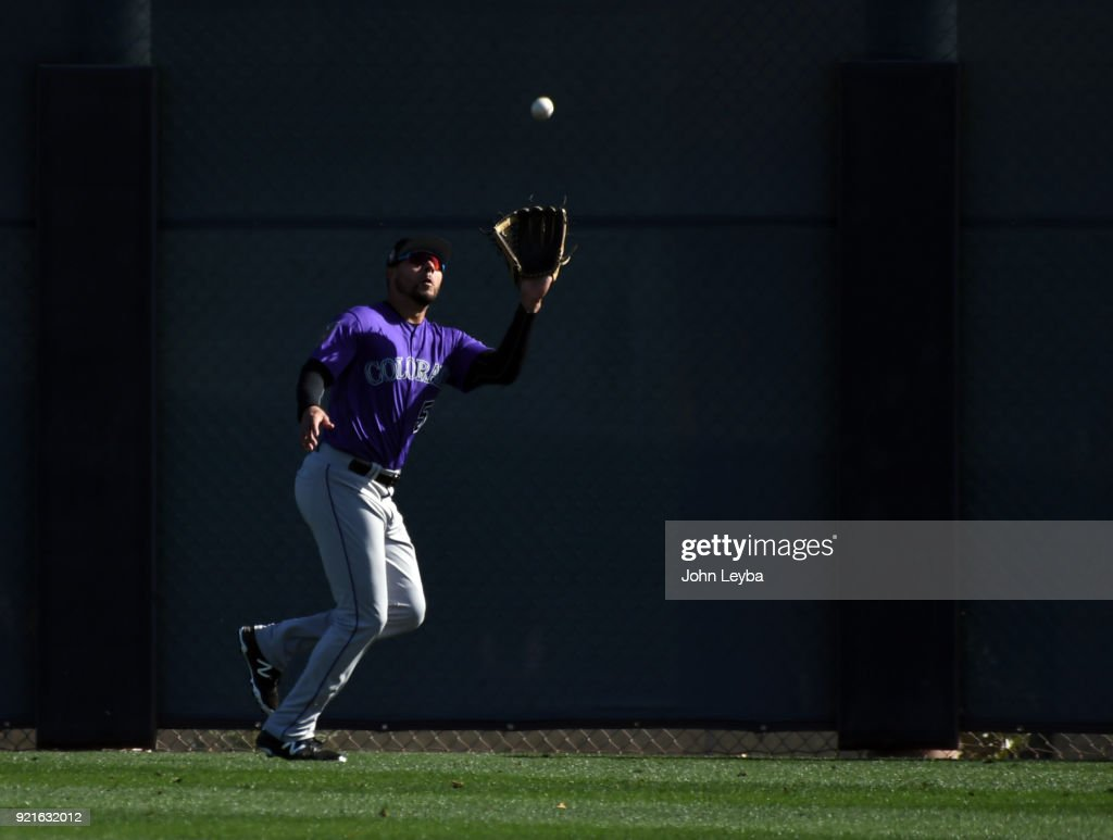 Colorado Rockies outfielder Noel Cuevas (56) catches a fly ball in drills on February 20, 2018 at Salt River Fields at Talking Stick in Scottsdale, Arizona.