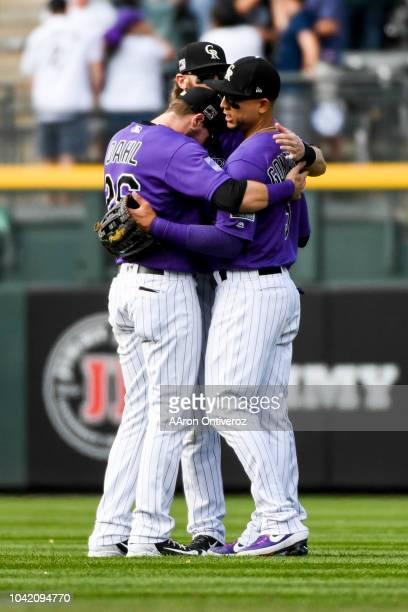 Colorado Rockies outfielders David Dahl , Charlie Blackmon and Carlos Gonzalez hug after the Rockies' 5-3 win over the Philadelphia Phillies at Coors...