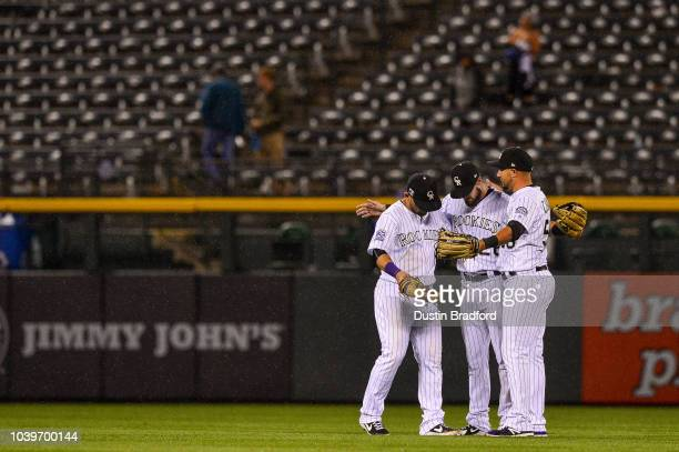 Colorado Rockies outfielders, from left, Gerardo Parra, David Dahl, and Noel Cuevas celebrate after a 10-1 win over the Philadelphia Phillies at...