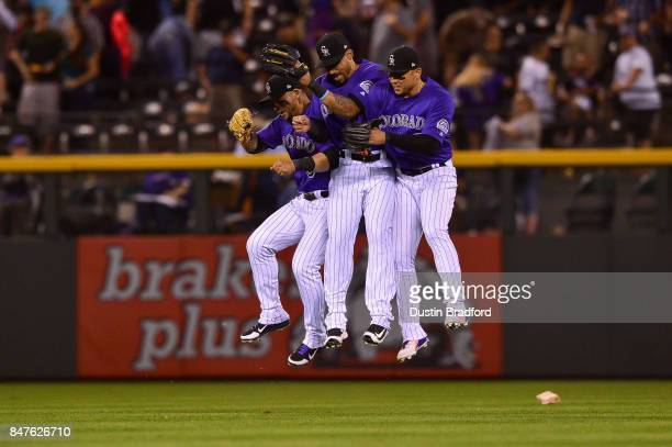 Colorado Rockies outfielders from left Gerardo Parra Ian Desmond and Carlos Gonzalez celebrate after a 61 win over the San Diego Padres at Coors...