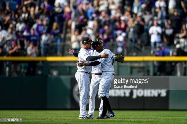 Colorado Rockies outfielders, from left, Noel Cuevas, David Dahl, and Raimel Tapia, celebrate after a 12-0 win over the Washington Nationals at Coors...