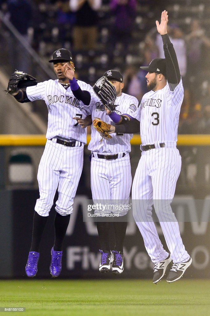 Colorado Rockies outfielders, from left, Raimel Tapia #7, Alexi Amarista #2, and Mike Tauchman #3, celebrate after a 16-0 win over the Colorado Rockies at Coors Field on September 16, 2017 in Denver, Colorado.