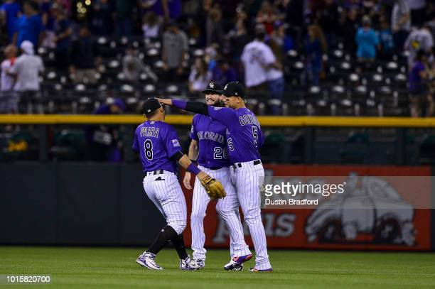 Colorado Rockies outfielders Gerardo Parra, David Dahl, and Carlos Gonzalez celebrate after a 2-0 win over the Pittsburgh Pirates at Coors Field on...