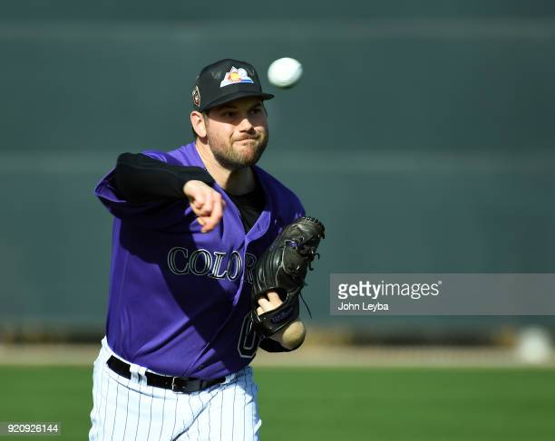 Colorado Rockies pitcher Adam Ottavino gets loose during the teams workout on February 19 2018 at Salt River Fields at Talking Stick in Scottsdale...