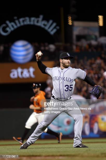 Colorado Rockies pitcher Chad Bettis throws to first to first to force out San Francisco Giants' Brandon Hicks after a sacrifice bunt in the sixth...
