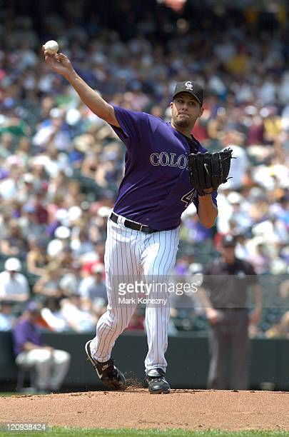 Colorado Rockies pitcher Jason Hirsh throws to first base during a game against against the Kansas City Royals at Coors Field in Denver Colorado on...