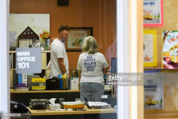 Colorado Rockies pitcher Kyle Freehand speaks to his mother Susan who is the secretary at Holm Elementary during a surprise visit for students on...