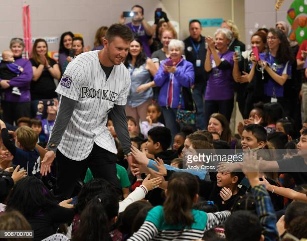 Colorado Rockies pitcher Kyle Freeland greets Holm Elementary School students on arrival for the Colorado Rockies Caravan Make an Impact rally at the...