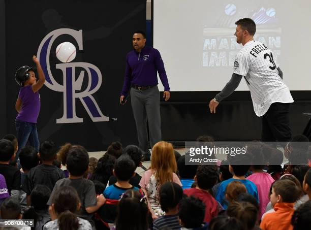 Colorado Rockies pitcher Kyle Freeland right pitches to Holm Elementary School 2nd grader Amani Teer during the Colorado Rockies Caravan Make an...