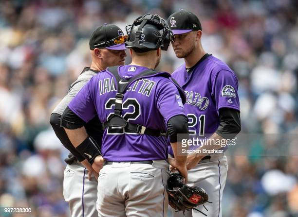 Colorado Rockies pitching coach Steve Foster catcher Chris Iannetta and starting pitcher Kyle Freeland of the Colorado Rockies meet at the pitcher's...
